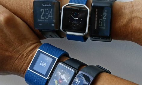 Six fitness tracking devices measuring step counts and other fitness features are worn Wednesday July 20, 2016