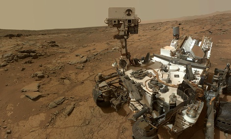 The Curiosity Rover on the surface of Mars.