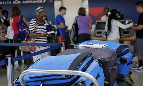 Bags wait to be checked at a Delta Air Lines counter at Baltimore-Washington International Thurgood Marshall Airport.