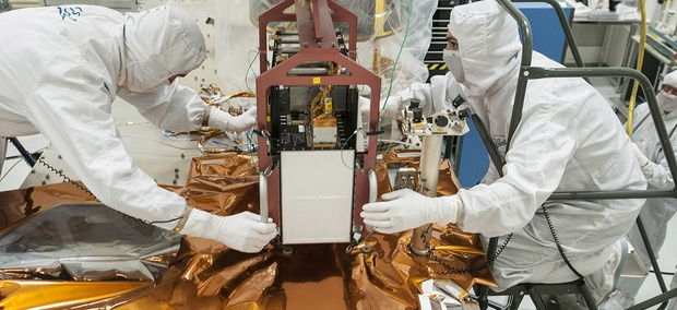 Technicians work on the JPSS spacecraft.