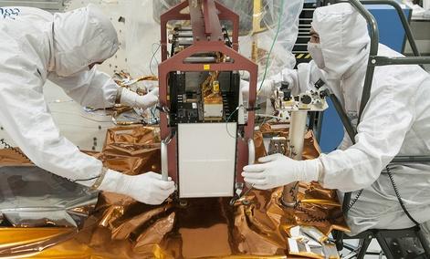 Technicians work on the JPSS spacecraft.