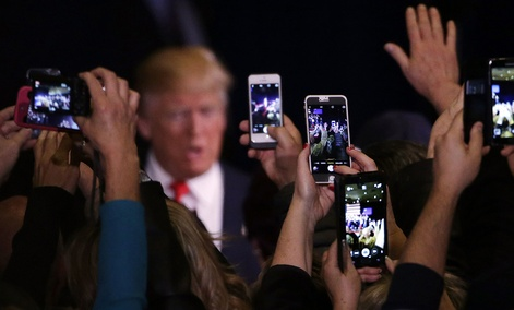 Supporters take cell phone photographs of Republican presidential candidate Donald Trump during a rally Tuesday, Feb. 23, 2016, in Reno, Nev.