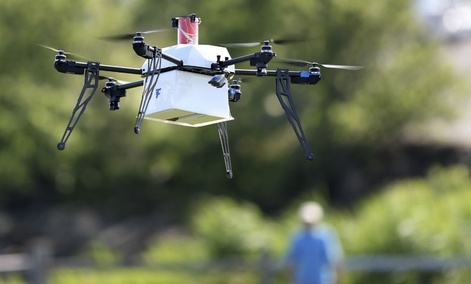 A drone aircraft carries simulated blood and other medical samples flies during a ship-to-shore delivery simulation Wed., June 22, 2016, in Lower Township, N.J.