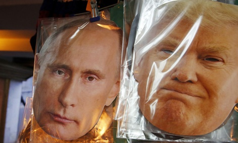 Face masks depicting Russian President Vladimir Putin and U.S. President-elect Donald Trump hang for sale at a souvenir street shop in St.Petersburg.