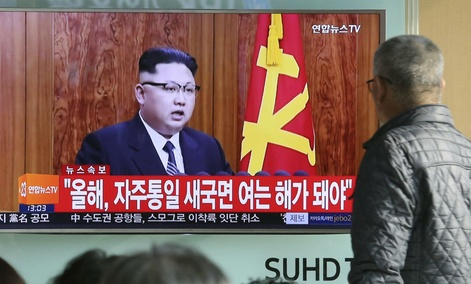 South Koreans watch a TV news program showing North Korean leader Kim Jong Un's 2017 New Year's speech, at the Seoul Railway Station in Seoul, South Korea.