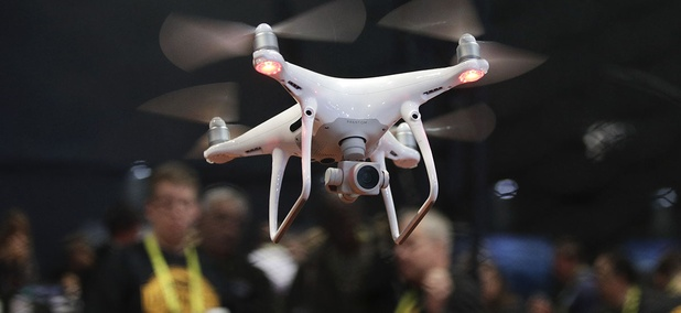 An exhibitor demonstrates a drone flight at CES International Thursday, Jan. 5, 2017, in Las Vegas.