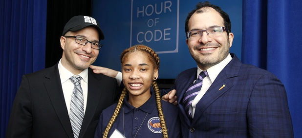 Iranian born Code.org founders Hadi Partovi, left, and Ali Partovi, right, pose with Adriana Mitchell, center, a middle school student from Newark, N.J.