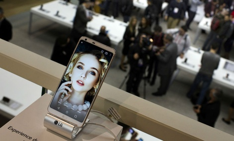 People crowd at the LG stand during the Mobile World Congress wireless show in Barcelona, Spain, Monday, Feb. 27, 2017.
