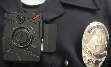 A a Los Angeles Police officer wears an on-body camera during a demonstration.