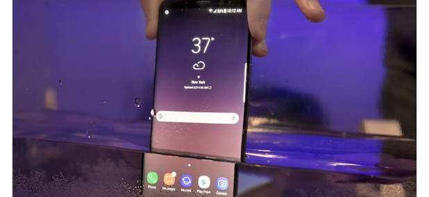 A Samsung Galaxy S8 mobile phone is shown partially submerged to demonstrate its water resistance, in New York, Friday, March 24, 2017.