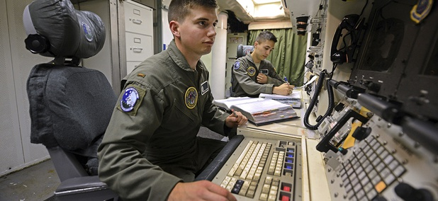 2nd Lt. Oliver Parsons, left, and 1st Lt. Andy Parthum check systems in the underground control room where they work a 24-hour shift at an ICBM launch control facility near Minot, N.D.