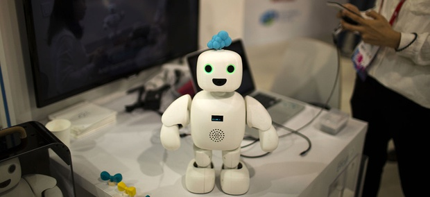 Pibo robot, whose main purpose is getting you and your loved ones sharing your daily life again, receives instructions from her owner at the Mobile World Congress.