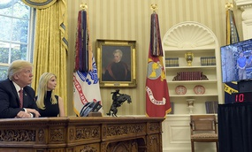 President Donald Trump, accompanied by his daughter Ivanka Trump, talks via video conference with International Space Station Commander Peggy Whitson.