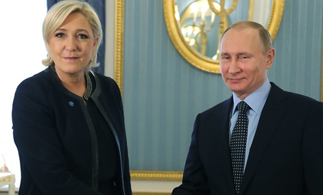 Russian President Vladimir Putin, right, shakes hands with French far-right presidential candidate Marine Le Pen, in the Kremlin in Moscow.