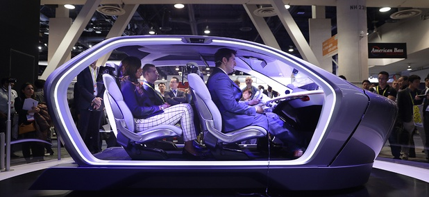 Show attendees sit in the Chrysler Portal self-driving concept car at CES International Thursday, Jan. 5, 2017.