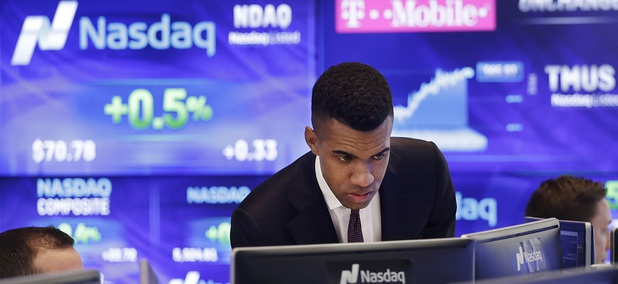 Brad Smith monitors stock prices at the Nasdaq MarketSite, Tuesday, April 25, 2017, in New York.