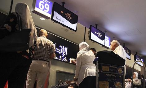 Passengers check into a flight at Abu Dhabi International Airport in Abu Dhabi, United Arab Emirates, Tuesday, July 4, 2017.