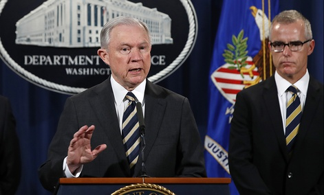 Attorney General Jeff Sessions, center, is flanked by Health and Human Services Secretary Tom Price, left, and Acting FBI Director Andrew McCabe.