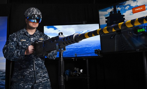 The Unified Gunnery System concept is an augmented reality (AR) helmet that fuses information from a ship's gunnery liaison officer and weapon system into an easy-to-interpret visual format for the gunner manning a naval gun system.