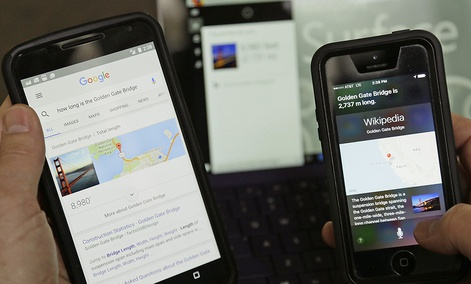 The Google, Cortana and Siri digital assistants on display.