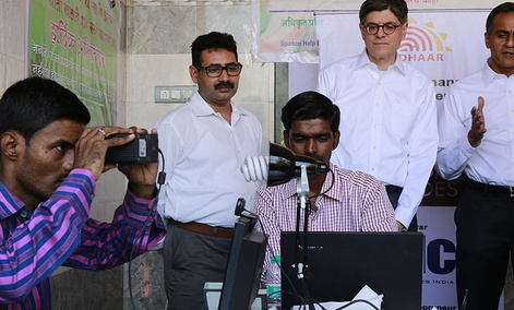Former Treasury Secretary Jack Lew, standing second right, visits an enrollment camp for Aadhaar, India's on going unique identification project at Koli Fishing Village in Mumbai, India
