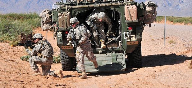Soldiers from 1st Squadron, 1st Cavalry Regiment, 2nd Brigade, 1st Armored Division, dismount from a Stryker vehicle during the Network Integration Evaluation 13.1 at Dona Ana Range, N.M.