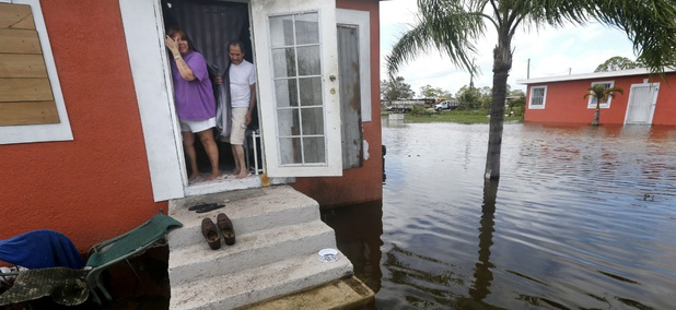 Florida residents look out at the flooding outside their home in the aftermath of Hurricane Irma in Immokalee, Fla., Monday, Sept. 11, 2017.