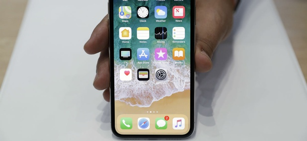 The new iPhone X is displayed in the showroom after the new product announcement at the Steve Jobs Theater on the new Apple campus on Tuesday, Sept. 12, 2017, in Cupertino, Calif.