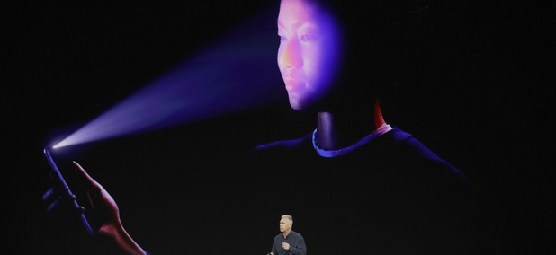 Phil Schiller, Apple's senior vice president of worldwide marketing, announces features of the new iPhone X at the Steve Jobs Theater on the new Apple campus on Tuesday, Sept. 12, 2017.