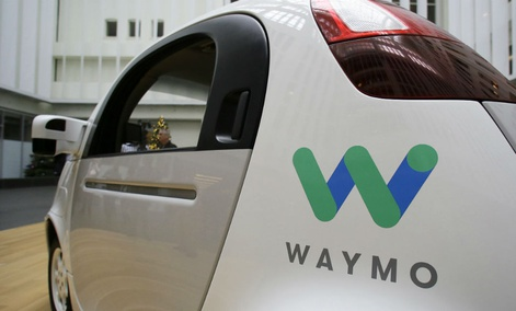 The Waymo driverless car is displayed during a Google event, in San Francisco.