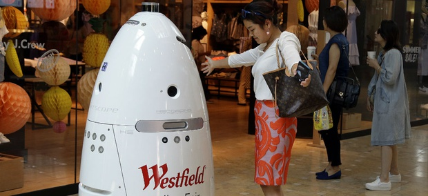 A K5 robot made by Knightscope, Inc. interacts with customers at the Westfield Valley Fair shopping center.