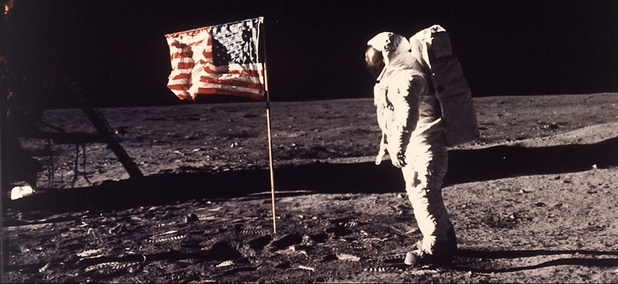 "Astronaut Edwin E. ""Buzz"" Aldrin Jr. poses for a photograph beside the U.S. flag deployed on the moon during the Apollo 11 mission on July 20, 1969."