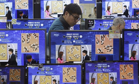 TV screens show the live broadcast of the Google DeepMind Challenge Match between Google's artificial intelligence program, AlphaGo, and South Korean professional Go player Lee Sedol, at the Yongsan Electronic store in Seoul, South Korea, March, 2016.