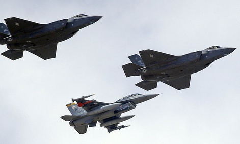 An F-16, below, escorting two F-35 jets, above, after arriving the latter arrived at Hill Air Force Base in Utah.