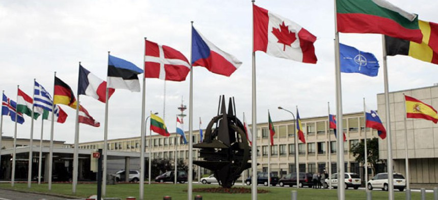 Flags fly at NATO headquarters in Brussels.