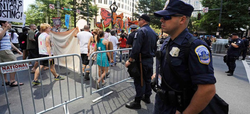 Charlotte police officers monitor a protest over the weekend.