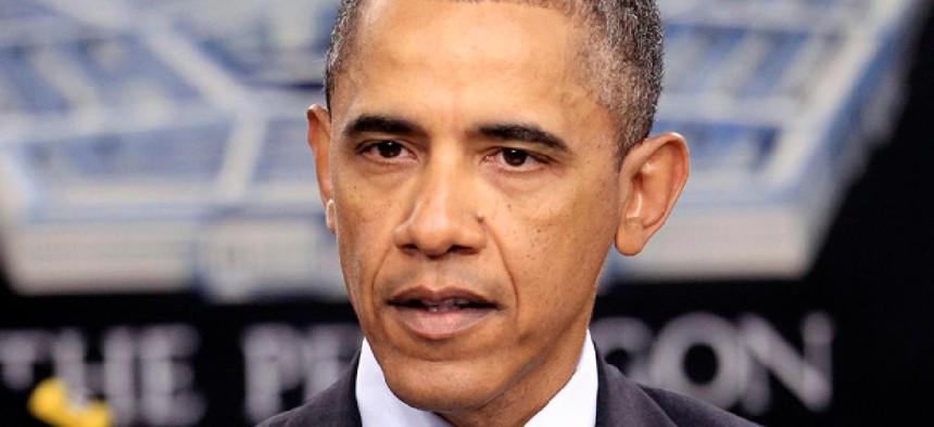 President Barack Obama speaks during a news briefing at the Pentagon.