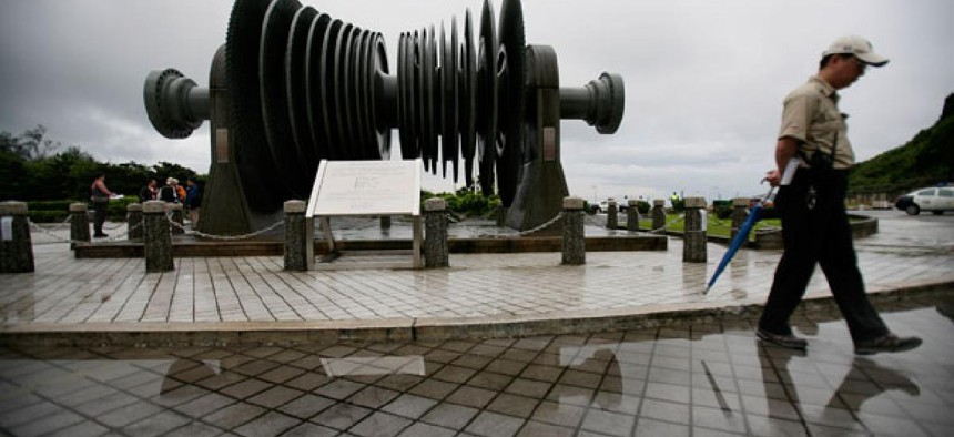 A security officer in 2011 walks past a low-pressure turbine rotor at an atomic energy site in Taiwan's Wanli district.