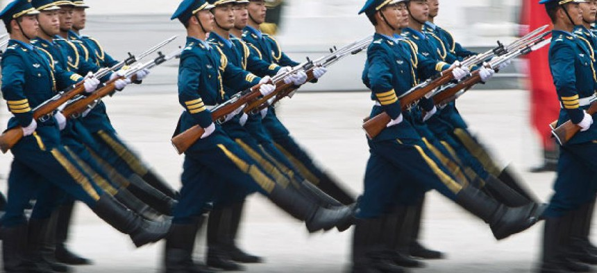 Soldiers of the Chinese People's Liberation Army's honor guard battalions march during a demonstration.