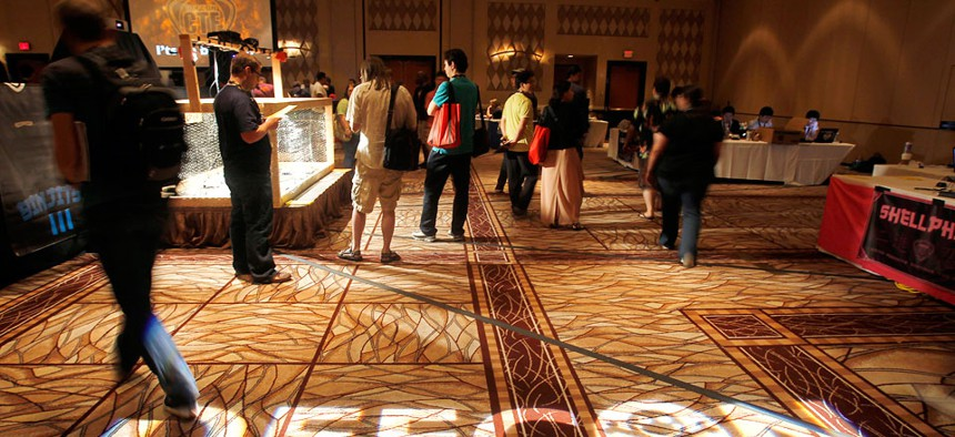 Hackers attend the DefCon conference 2011 in Las Vegas.
