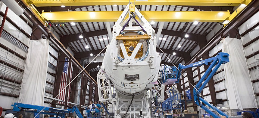 Technicians prepare for the SpaceX 1 mission launch at Cape Canaveral Air Force Station, Fla. in 2012.