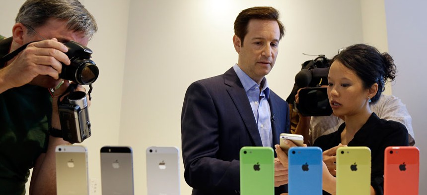 Media members review the new iPhone models this week.