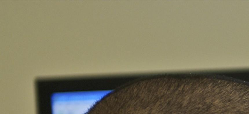 Sgt. Nirundorn Chiv works in the virtual lab at Fort Gordon in 2010.