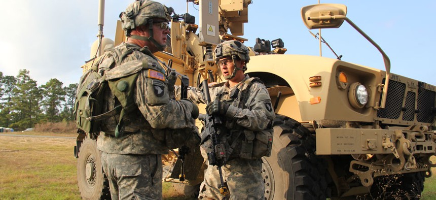 Soldiers from the 2nd Brigade Combat Team, 101st Airborne Division utilize Warfighter Information Network-Tactical Increment 2-equipped vehicles.