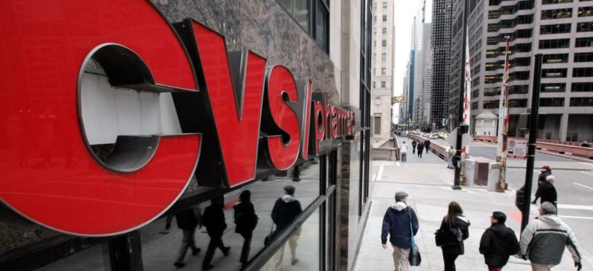 Pedestrians walk pass a CVS store in Chicago.