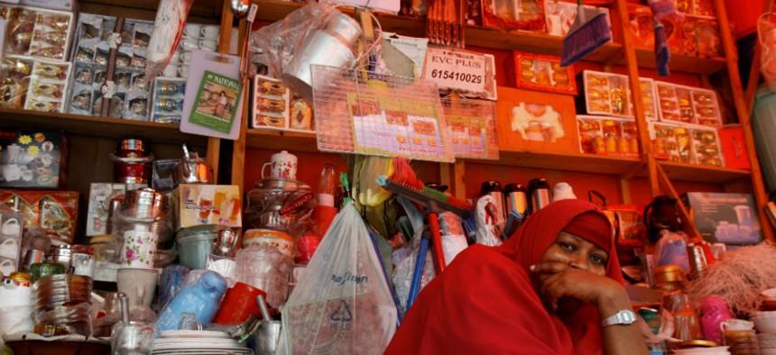 A Somali shopkeeper sells kitchen utensils sits in her shop in Mogadishu, Somalia.