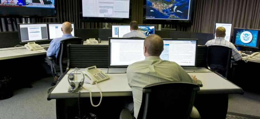 """Cyber security analysts work in the """"watch and warning center"""" at DHS' cyber defense lab."""