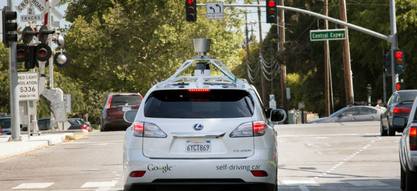 A Google driverless car navigating along a street in Mountain View, California.