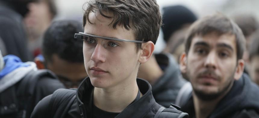 An Apple Worldwide Developers Conference attendee wears Google Glass in San Francisco.