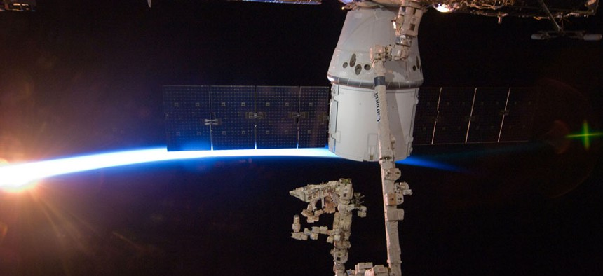 The SpaceX Dragon capsule berths at the International Space Station